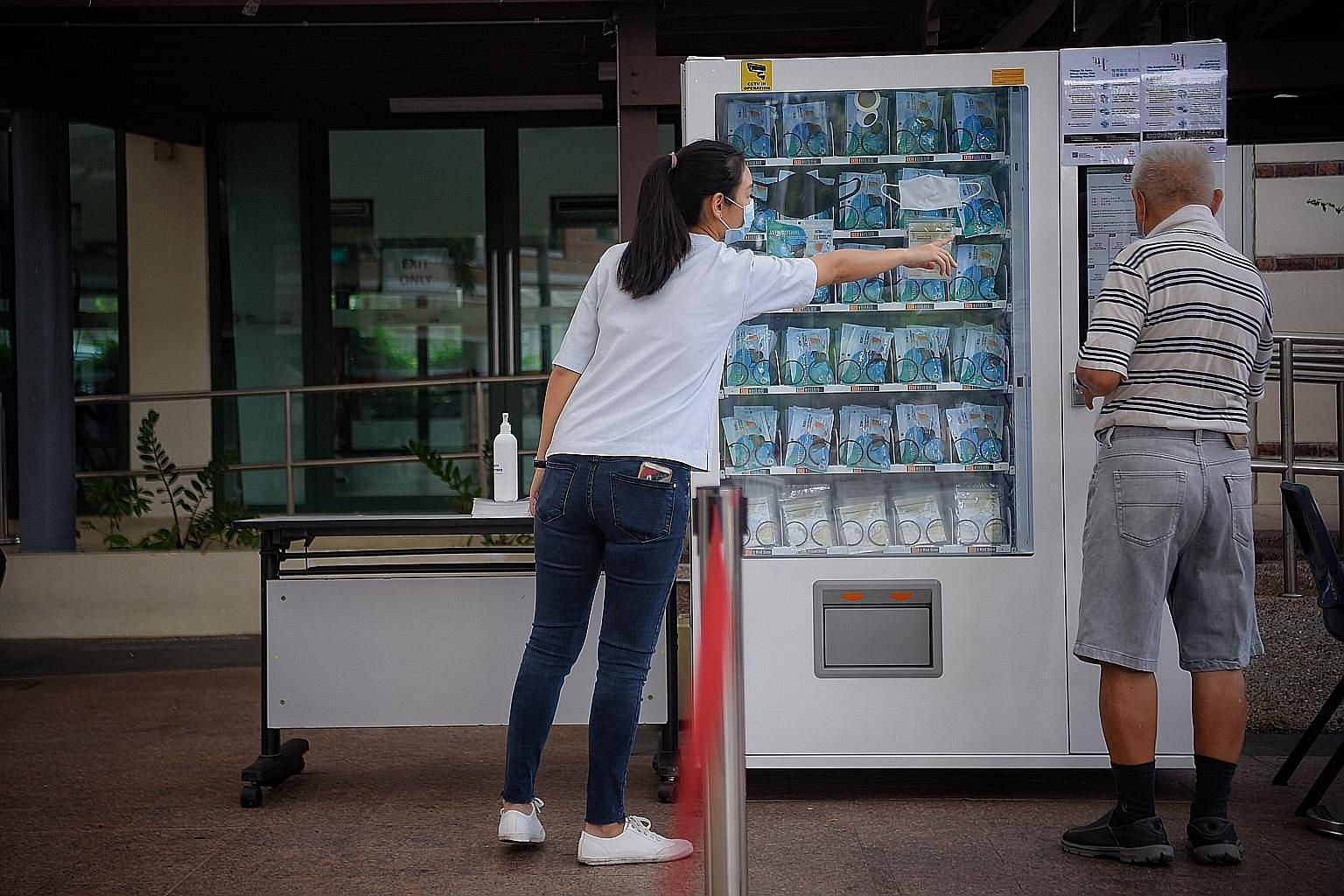 A mask vending machine at Bishan Community Club. The latest mask distribution exercise follows three earlier ones by the Government.
