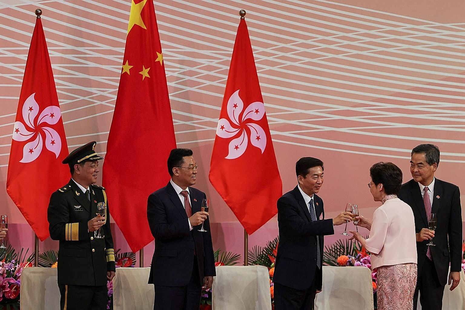 Hong Kong Chief Executive Carrie Lam and Mr Luo Huining, head of China's liaison office in the territory, clinking glasses at a ceremony to mark the city's handover anniversary last Wednesday. PHOTO: REUTERS