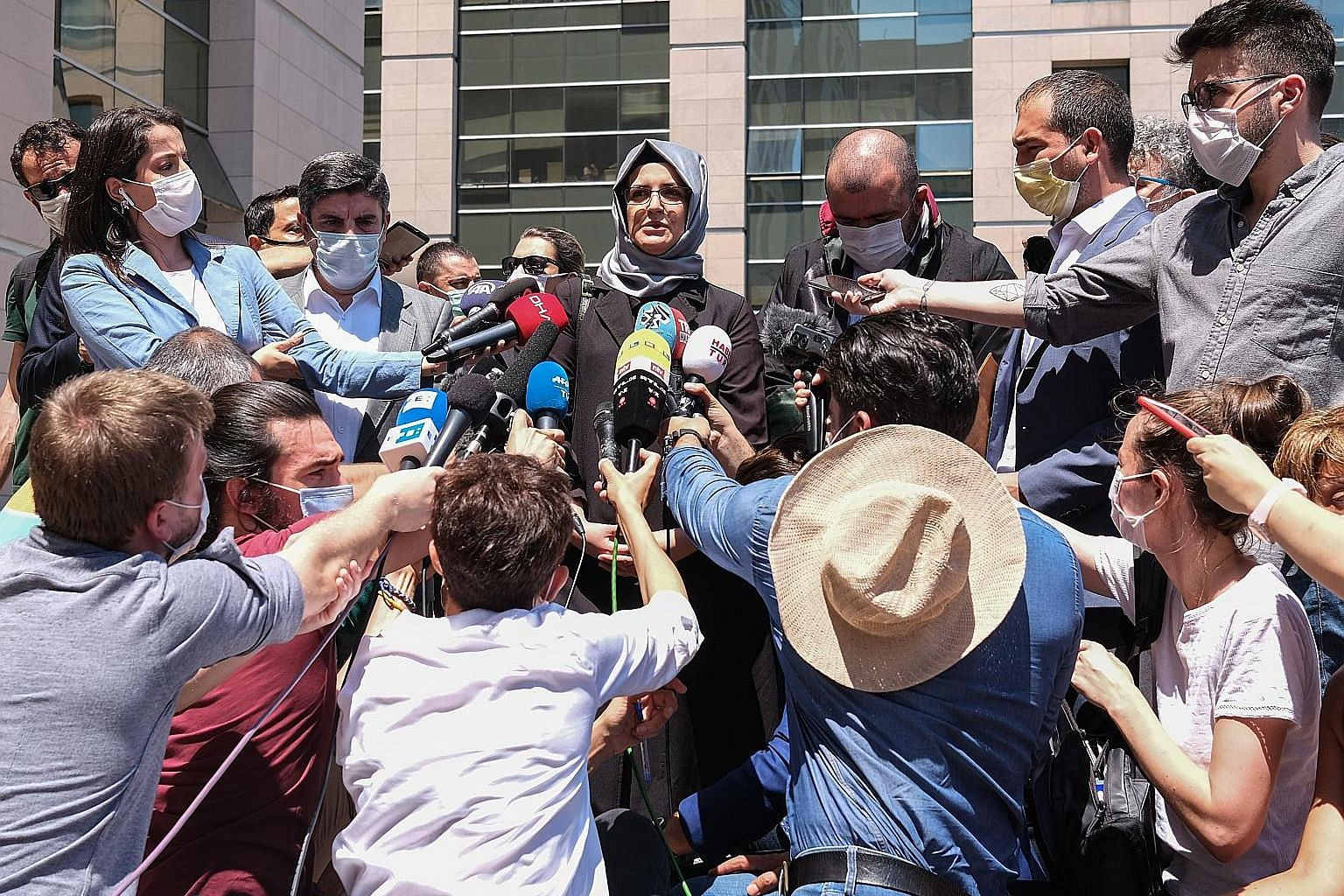 Ms Hatice Cengiz (top), the fiancee of Saudi journalist Jamal Khashoggi, speaking after the first session of his murder trial in Istanbul on Friday. PHOTOS: EPA-EFE