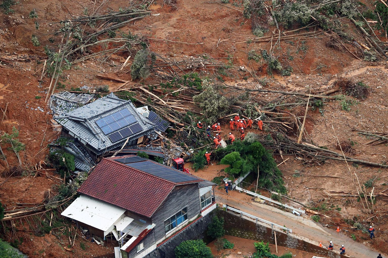 Rescue operations being carried out at a collapsed house in Ashikita town in Kumamoto prefecture, south-western Japan, on Saturday. PHOTO: EPA-EFE