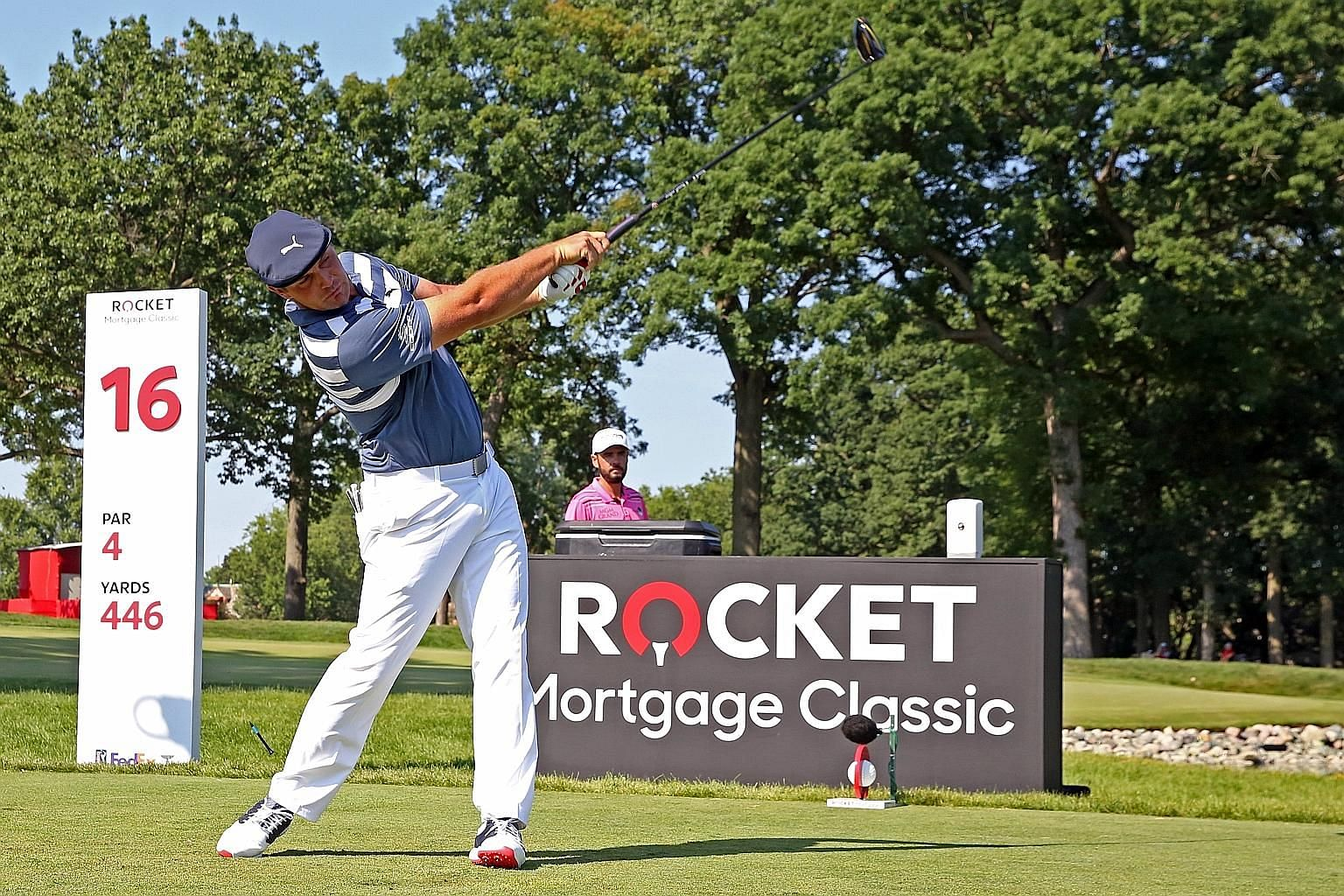 Bryson DeChambeau, who piled on 9kg during the tour's halt, hitting his tee shot on the 16th hole in the final round of the Rocket Mortgage Classic at the Detroit Golf Club. His longest drive this year is 428 yards.
