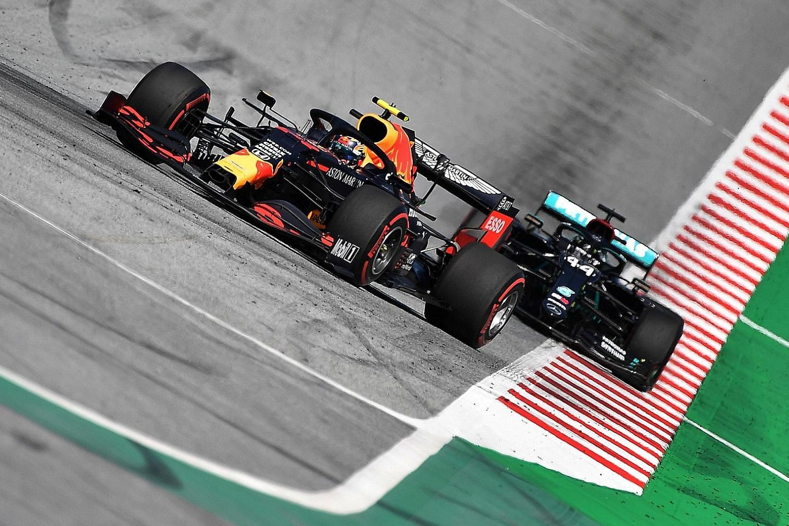 Red Bull driver Alexander Albon leading Mercedes' Lewis Hamilton during the Austrian Grand Prix on Sunday. The two would touch later on with Hamilton incurring a time penalty and Albon's race ending with engine trouble. PHOTO: REUTERS