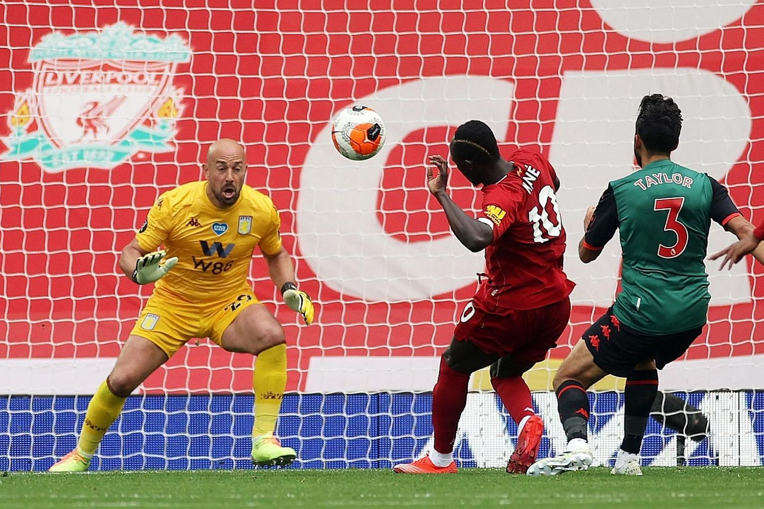 Liverpool's Sadio Mane scoring past goalkeeper Pepe Reina for a sixth goal in his past five Premier League appearances against Aston Villa. Curtis Jones sealed the 2-0 win late on. PHOTO: REUTERS