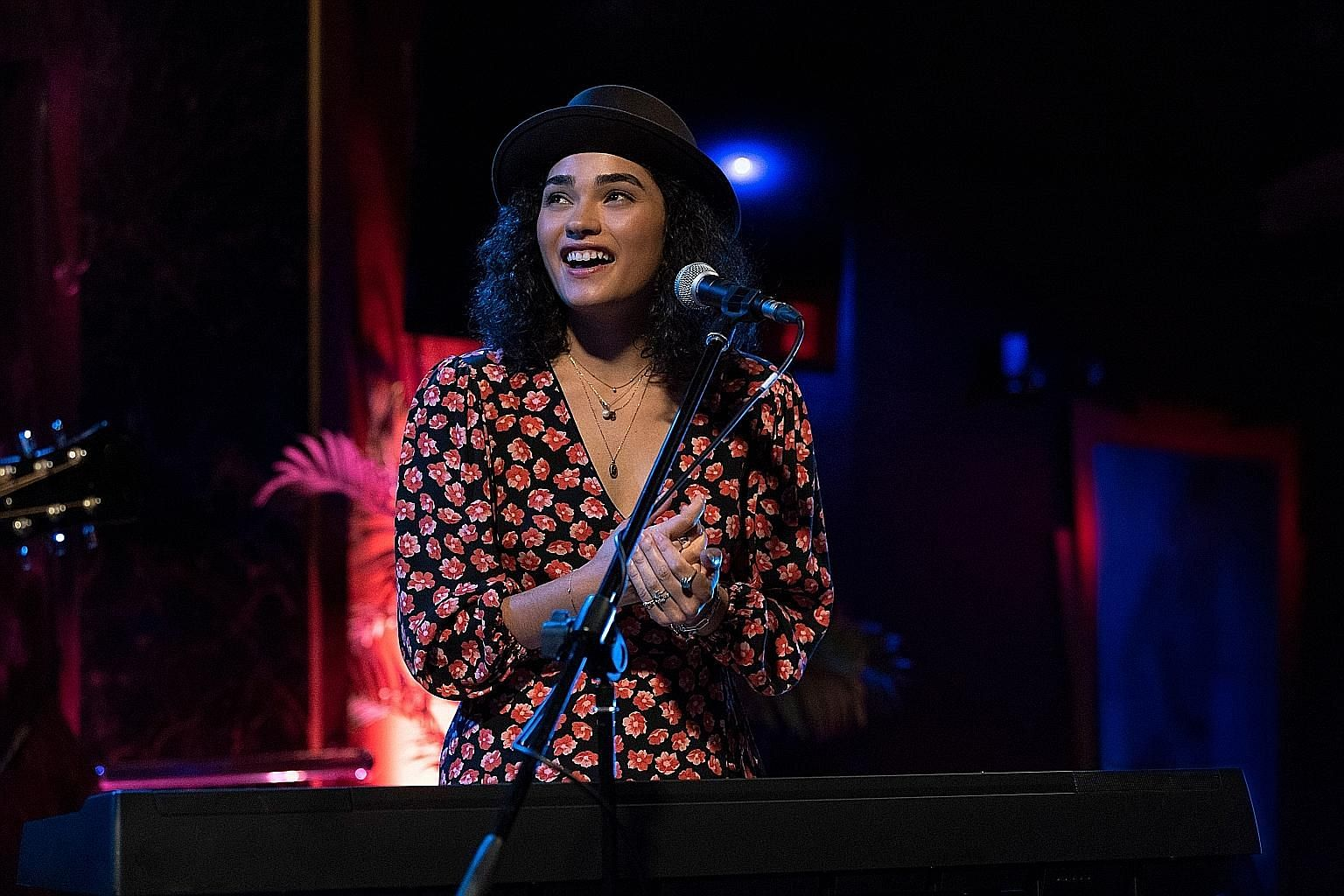 Brittany O'Grady (above) in Little Voice as Bess, a shy young singer who is afraid to perform on stage. The series is inspired by singer-songwriter Sara Bareilles (left, in a performance in Singapore in 2014).