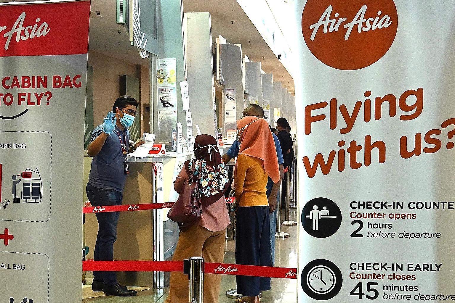 An AirAsia counter at Penang International Airport. The airline said it is in talks for joint ventures and collaborations that may result in additional investment, and it has also applied for bank loans.