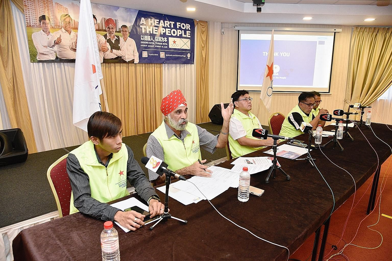 Singapore Democratic Alliance candidates for Pasir Ris-Punggol GRC (from left) Kelvin Ong, Harminder Pal Singh, Desmond Lim Bak Chuan, Abu Mohamed and Kuswadi Atnawi at a media conference in Changi yesterday.