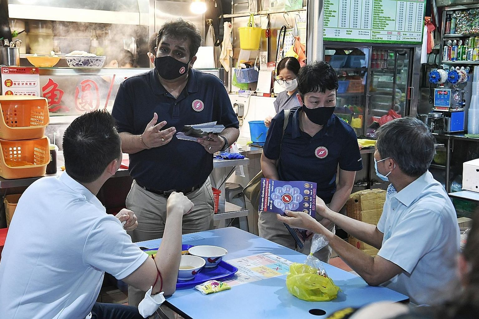 Red Dot United secretary-general Ravi Philemon and chairman Michelle Lee meeting residents at Jurong West 505 Market and Food Centre yesterday. Mr Philemon said the party's raison d'etre is to give voters a choice, regardless of how tough the fight m