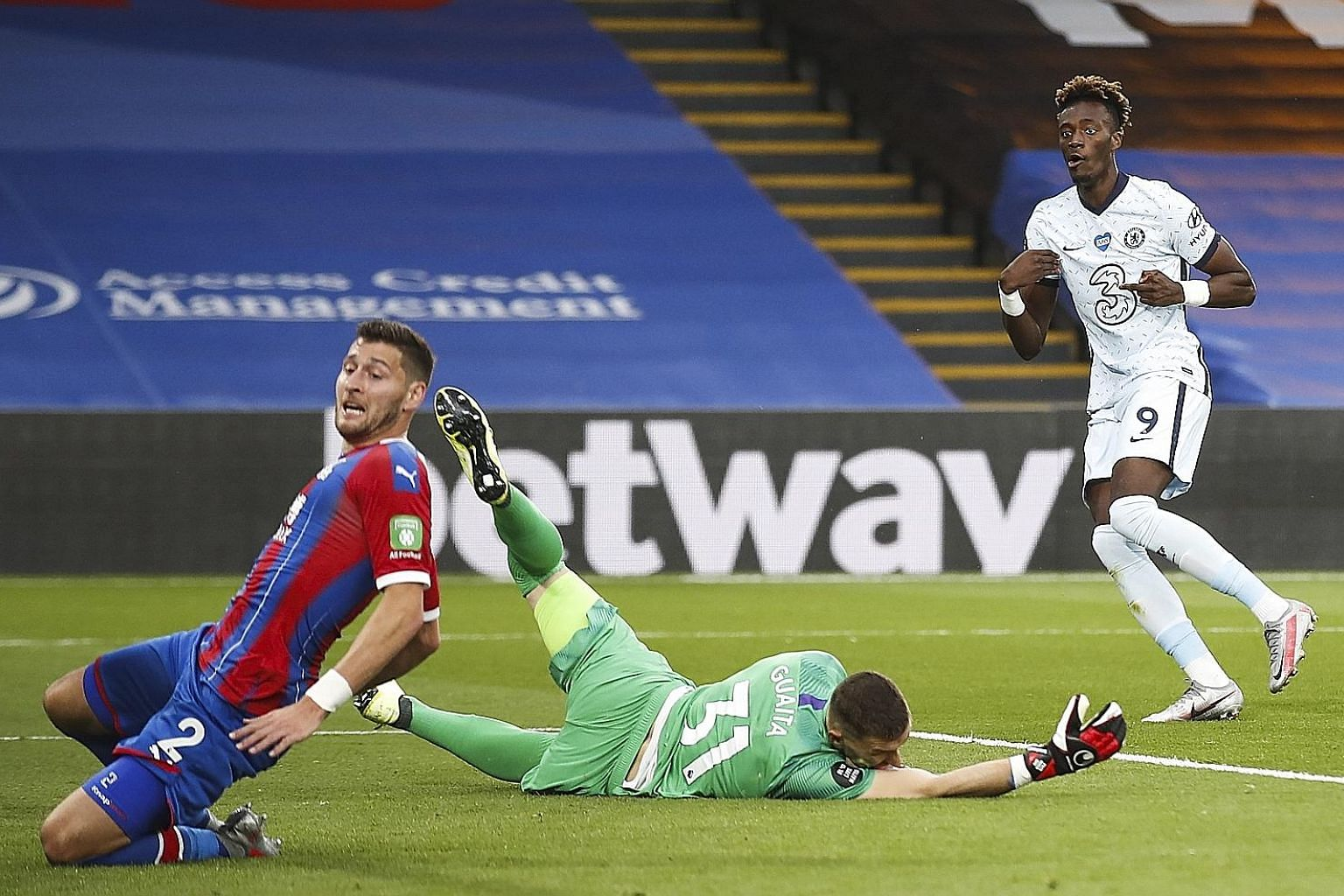 Tammy Abraham (in white) giving Chelsea a 3-1 lead during their Premier League match against Crystal Palace at Stamford Bridge in London on Tuesday. Chelsea won 3-2. PHOTO: EPA-EFE