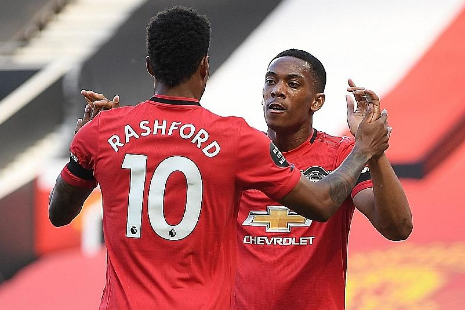 Anthony Martial celebrating with Marcus Rashford after scoring the first of his three goals in Manchester United's 3-0 victory over Sheffield United last month. The duo both scored in last weekend's 5-2 win over Bournemouth. PHOTO: EPA-EFE