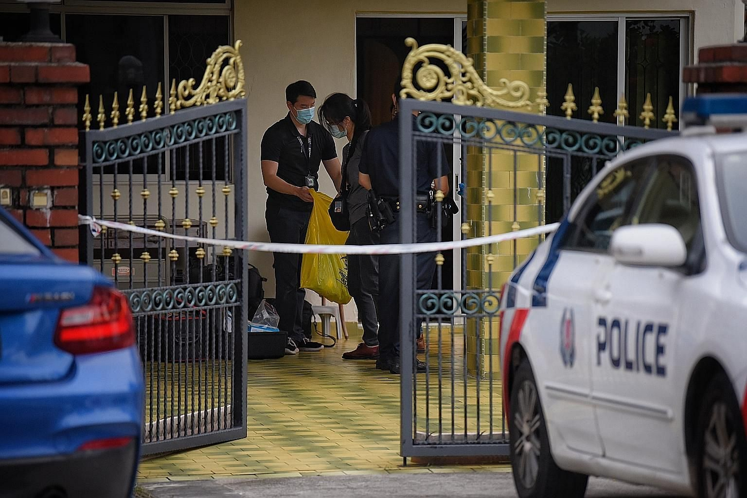 Madam Ang Pek Chai, 95, was found lying motionless in the two-storey semi-detached house off Upper Serangoon Road on Monday. Police officers were seen leaving with bags of evidence later that day. ST PHOTO: MARK CHEONG