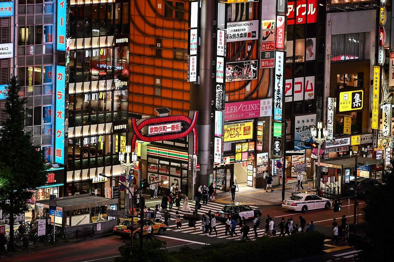 The entertainment district of Kabukicho in Tokyo on June 24. The Tokyo metropolitan government will give $6,500 to nightclubs if they close for more than 10 days.