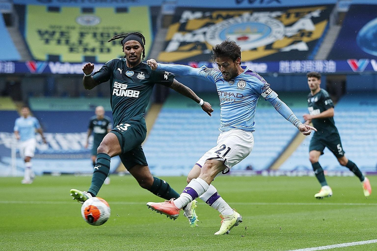 Manchester City's David Silva, seen shooting under pressure from Newcastle's Valentino Lazaro, scored from a free kick and set up goals for Gabriel Jesus and Raheem Sterling in City's 5-0 win on Wednesday. PHOTO: REUTERS