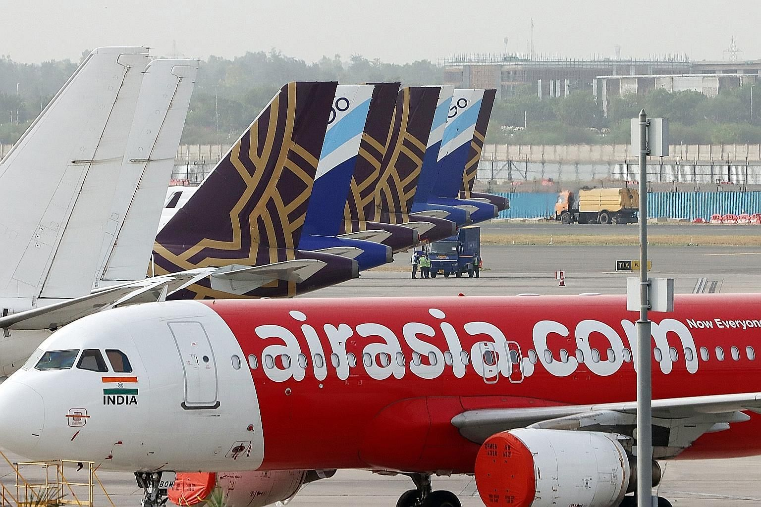 AirAsia, like other airlines, has been slammed by the coronavirus pandemic that has hammered demand for air travel. The airline said it has begun to cut jobs and salaries to save costs, and is working on extensions with lessors. PHOTO: BLOOMBERG
