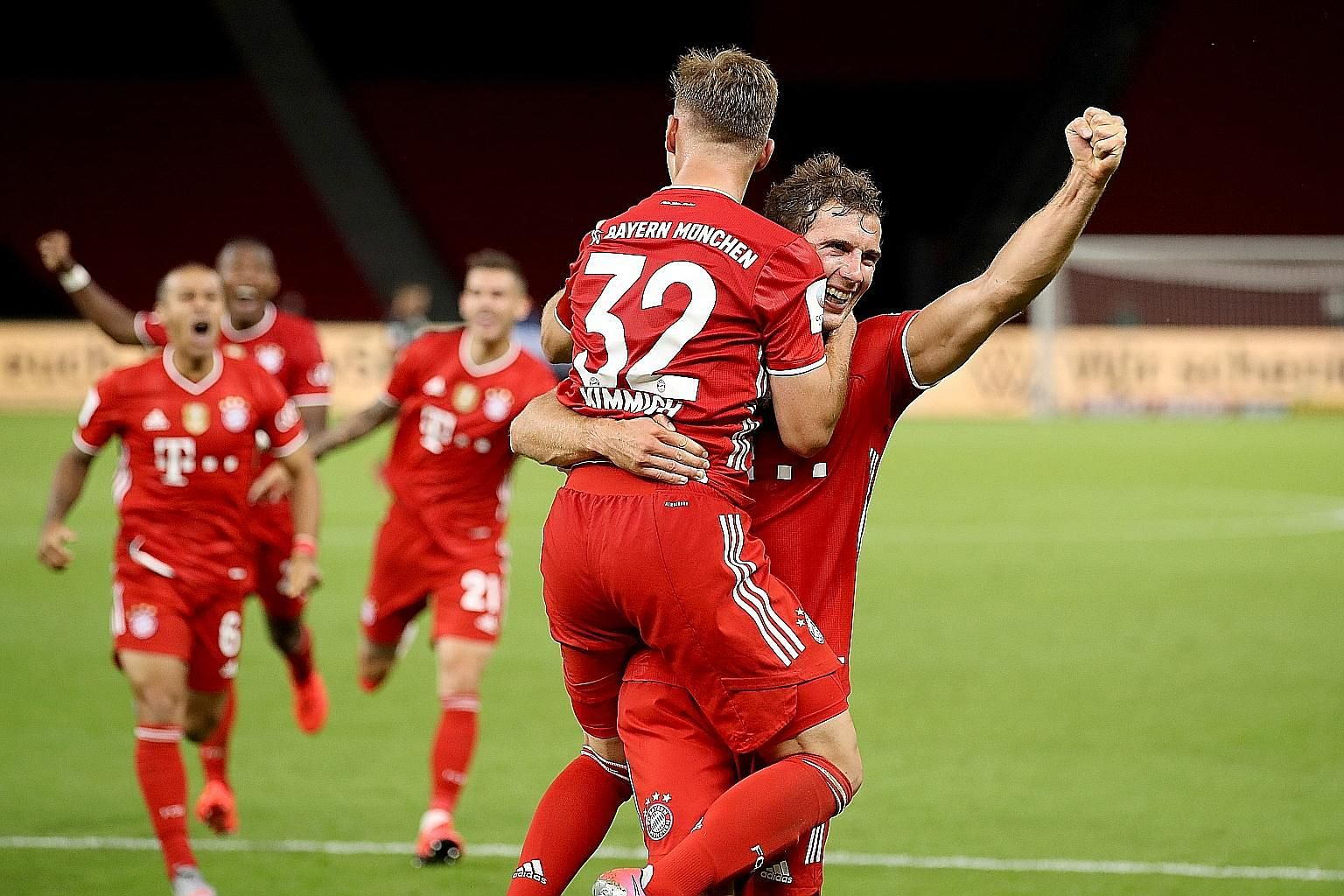 Bayern Munich's Leon Goretzka (right) and Joshua Kimmich celebrating their fourth goal against Bayer Leverkusen at Berlin's Olympic Stadium on July 4. The newly-crowned Bundesliga champions' 4-2 win in the German Cup final secured their second trophy