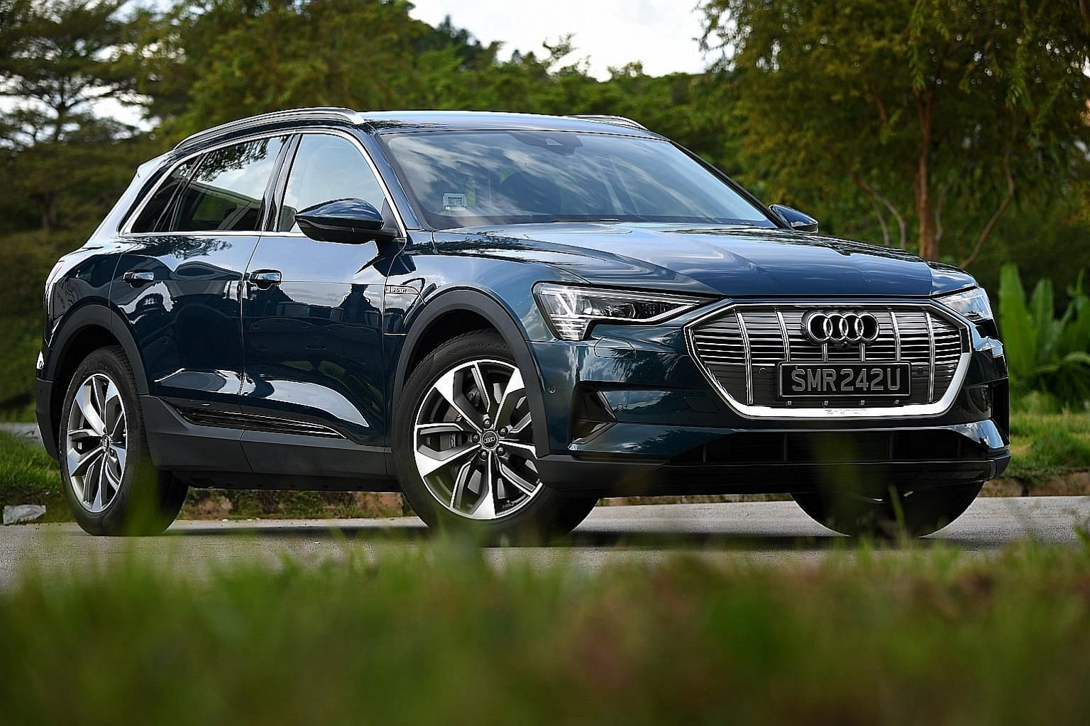 The stand-out feature of the Audi e-tron (above) is the shift lever, which is actually a small thumb-operated slide clicker situated on a palm rest styled like a nautical throttle; It is pleasantly responsive, with not one instance of missed engagement.