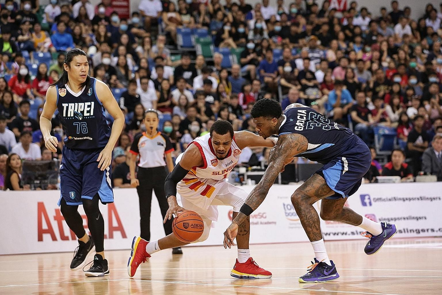 Singapore Slingers' Xavier Alexander (centre) taking on the Taipei Fubon Braves in February. Both teams are set to compete in the Asean Basketball League when the new season resumes next year.