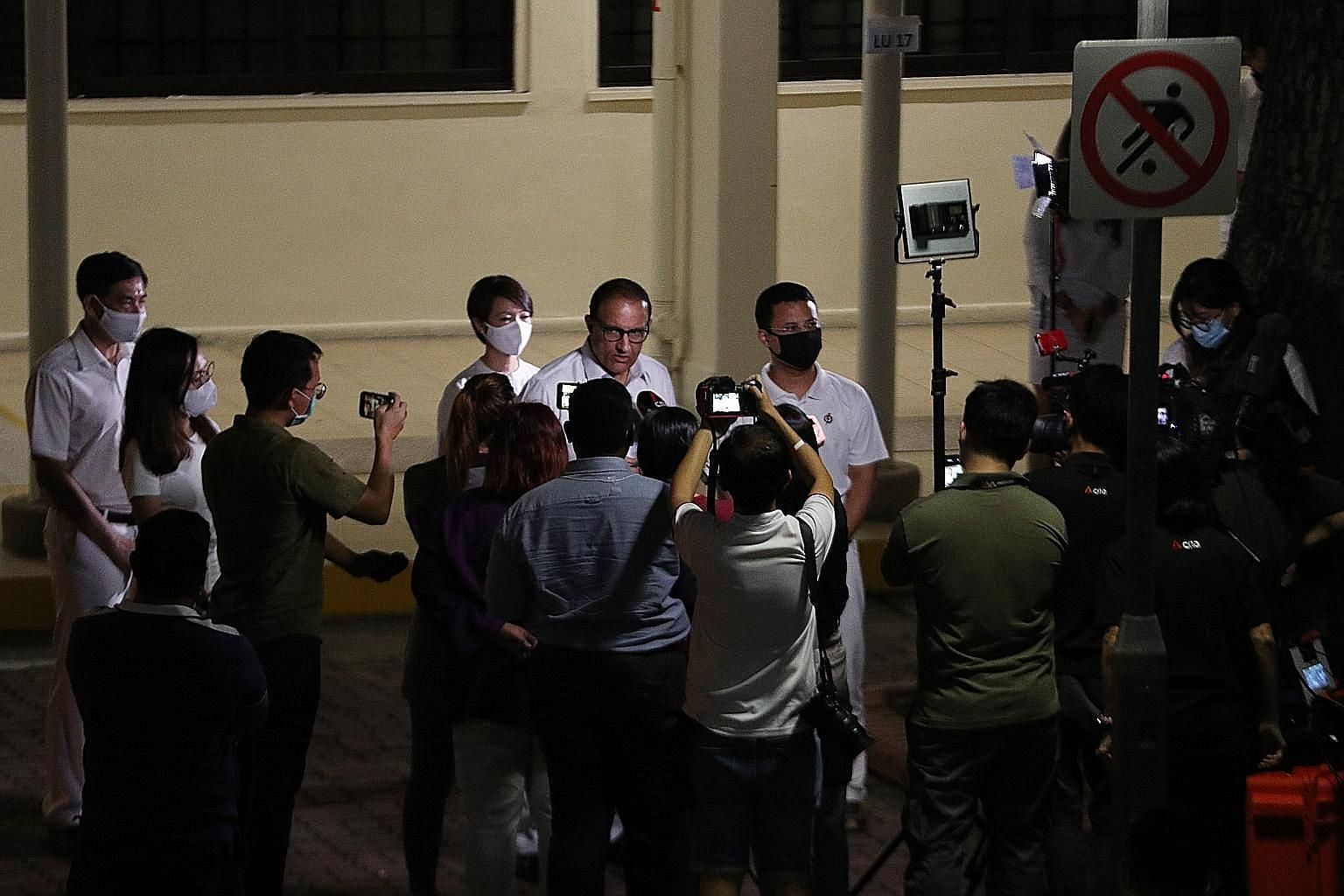 Communications and Information Minister S. Iswaran, surrounded by members of his PAP team for West Coast GRC, speaking to reporters in Clementi early this morning after their win against the Progress Singapore Party.