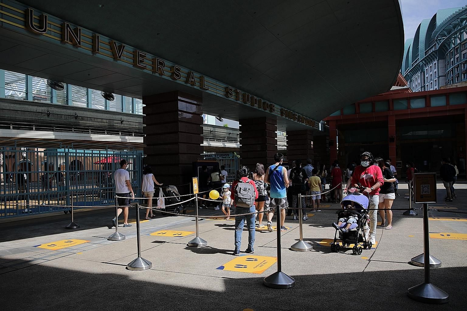 Visitors entering Universal Studios Singapore on July 4, about a month after the economy started reopening. Domestically, the dim outlook over a full resumption of tourism, weak retail sales and rising unemployment will continue to weigh down growth in th