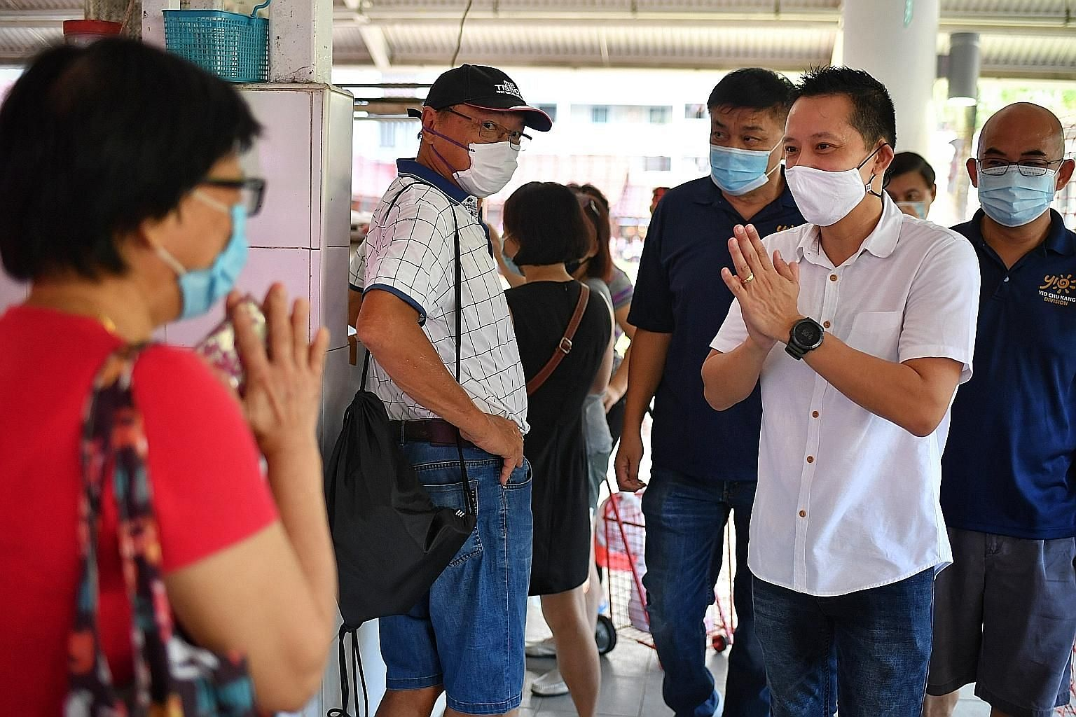 Above left: The People's Action Party's Mr Yip Hon Weng, the newly elected MP for Yio Chu Kang SMC, greeting residents at the Ang Mo Kio 628 Market yesterday morning. Mr Yip, who said ageing issues remain a priority, will continue to engage residents