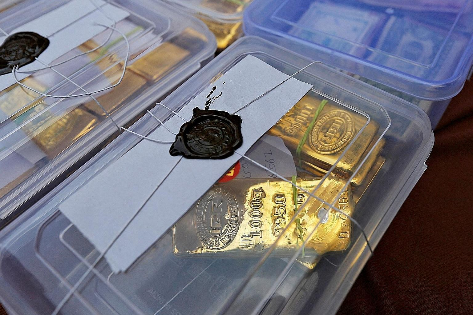 Seized gold bars on display at a police station in Ahmedabad city in India's western state of Gujarat in 2015. Gold smuggling is a major problem for the Indian authorities as the yellow metal is prized both as jewellery and as an investment for a rai