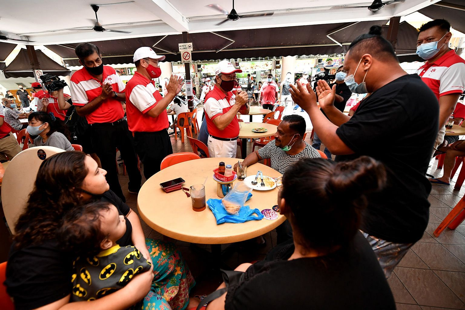 Right: Progress Singapore Party's West Coast GRC team members (from left) Nadarajah Loganathan, Jeffrey Khoo and Tan Cheng Bock greeting residents at a coffee shop in Teban Gardens yesterday. ST PHOTO: LIM YAOHUI