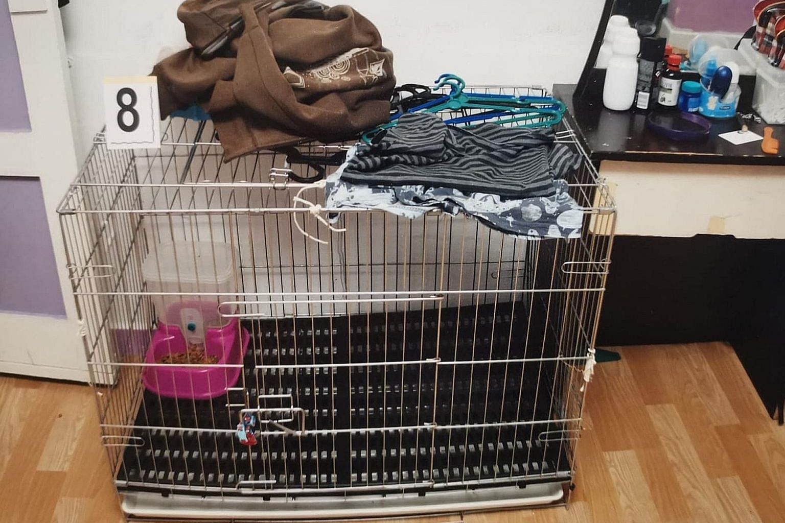 The five-year-old victim's parents also committed other acts of abuse against the boy, including confining him in a pet cage (above) and pinching him with a pair of pliers. Ridzuan Mega Abdul Rahman and Azlin Arujunah splashed hot water on their five
