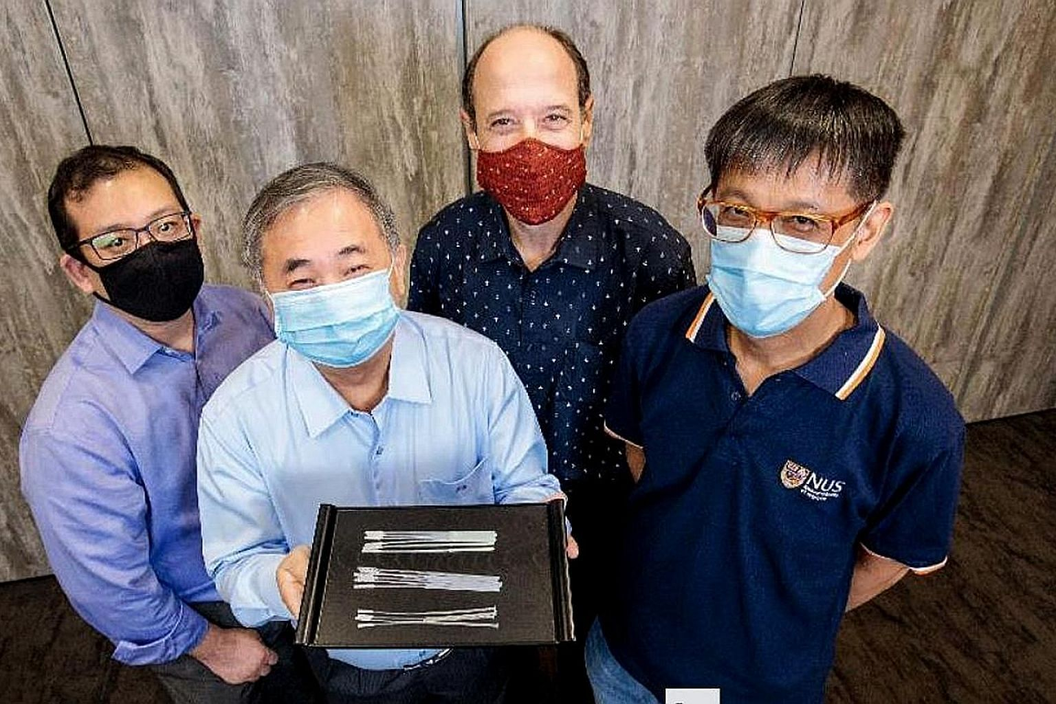 Professor Freddy Boey with the swabs. With him are (from left) Dr Alfred Chia, Associate Professor David Allen and Associate Professor Yen Ching-Chiuan. They are part of two National University of Singapore teams that came up with three nasopharyngea