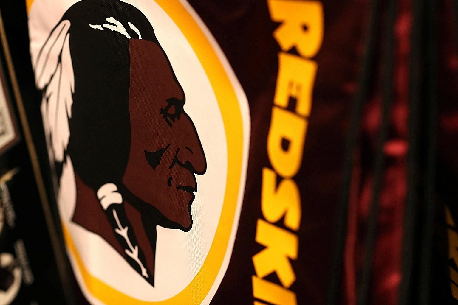 Redskins-branded merchandise on display in a sports store as the Washington NFL team announced the logo and name would no longer be used. PHOTO: REUTERS