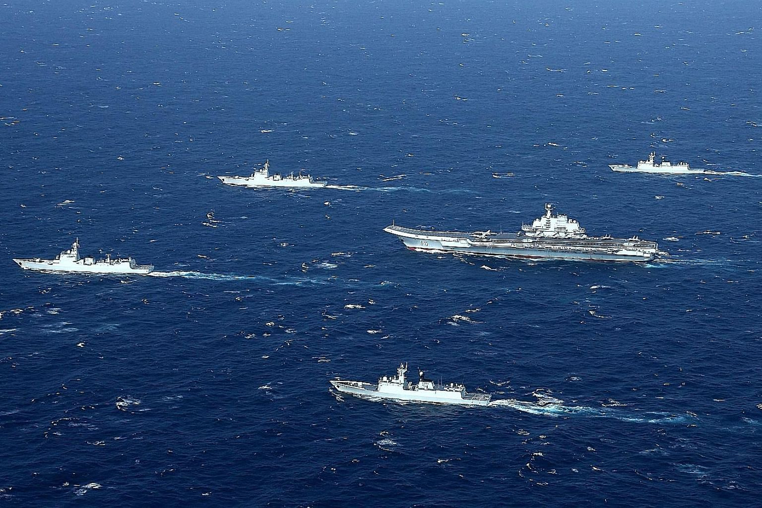 """A January 2017 photo showing Chinese military drills in the South China Sea. China claims a large swathe of the South China Sea within its """"nine-dash line"""", including waters and maritime entitlements within the exclusive economic zones of other coast"""