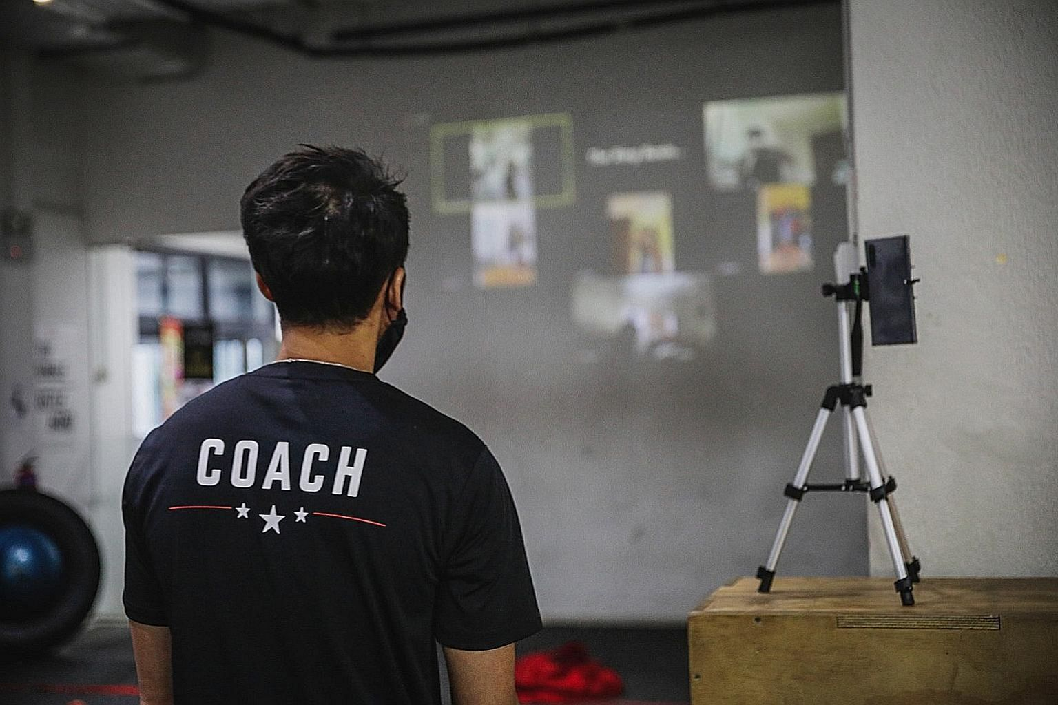 "Hamzah Farouk of The Ring Boxing Community conducting a virtual class with members to give them ""a more integrated experience"". PHOTO: BACK ALLEY MEDIA"