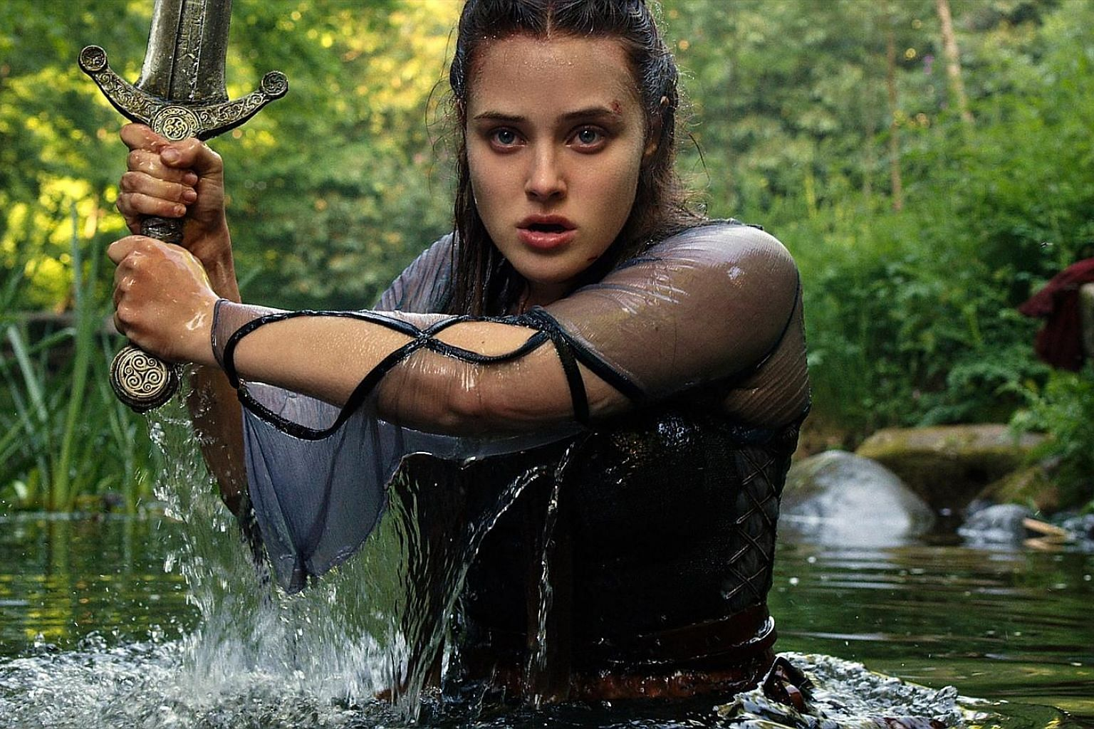 Cursed stars Australian actress Katherine Langford as Nimue, the Lady of the Lake.