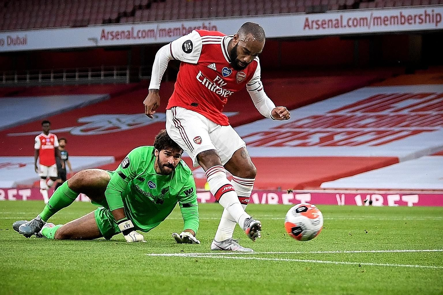 Arsenal forward Alexandre Lacazette beating Liverpool goalkeeper Alisson Becker to score the equaliser in their Premier League match at the Emirates on Wednesday. Arsenal went on to record a 2-1 win and become only the third team to beat the champion