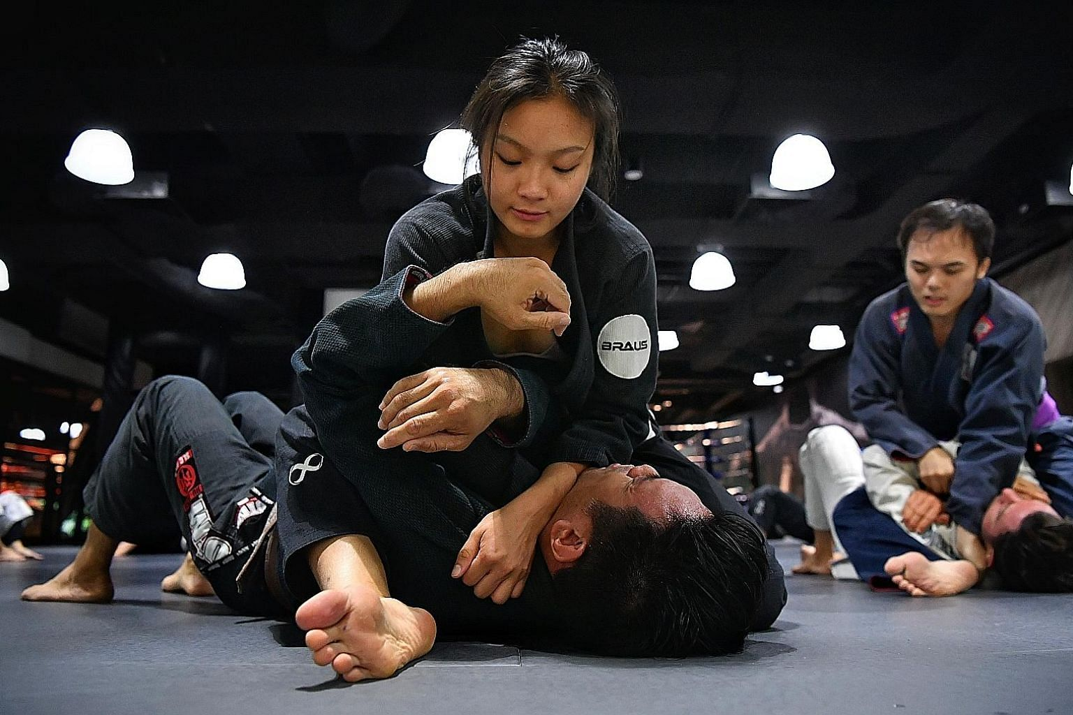 Singapore jiu-jitsu exponent Constance Lien in training in January before the circuit breaker measures were imposed. During the time in isolation, she has been making do with strength and conditioning exercises and training on dummies.