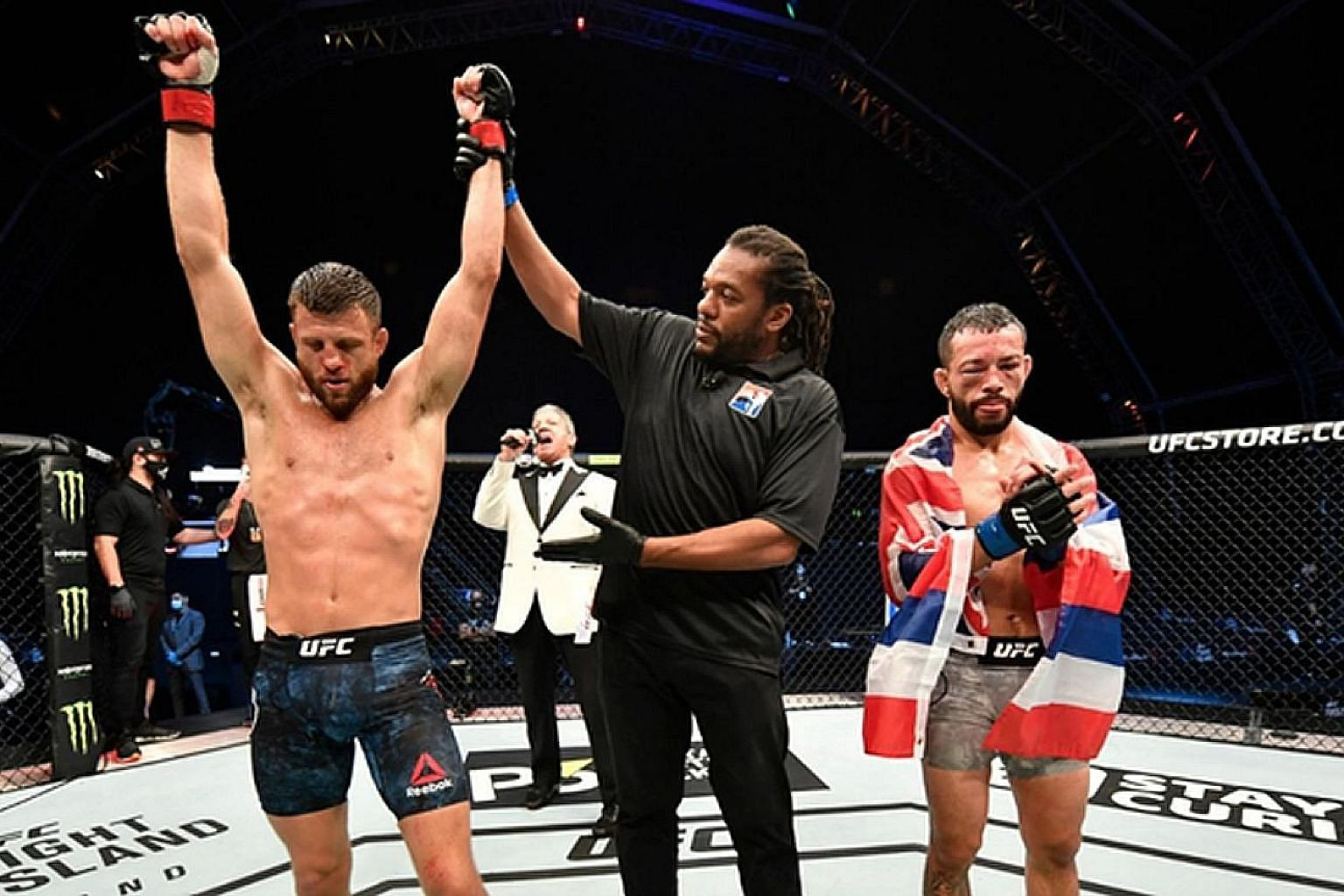 The referee lifting the hand of Calvin Kattar after he gave a power-packed boxing display against Dan Ige to win the UFC Fight Night 172 featherweight main event by unanimous decision. Wednesday's victory on Abu Dhabi's Yas Island made American Katta