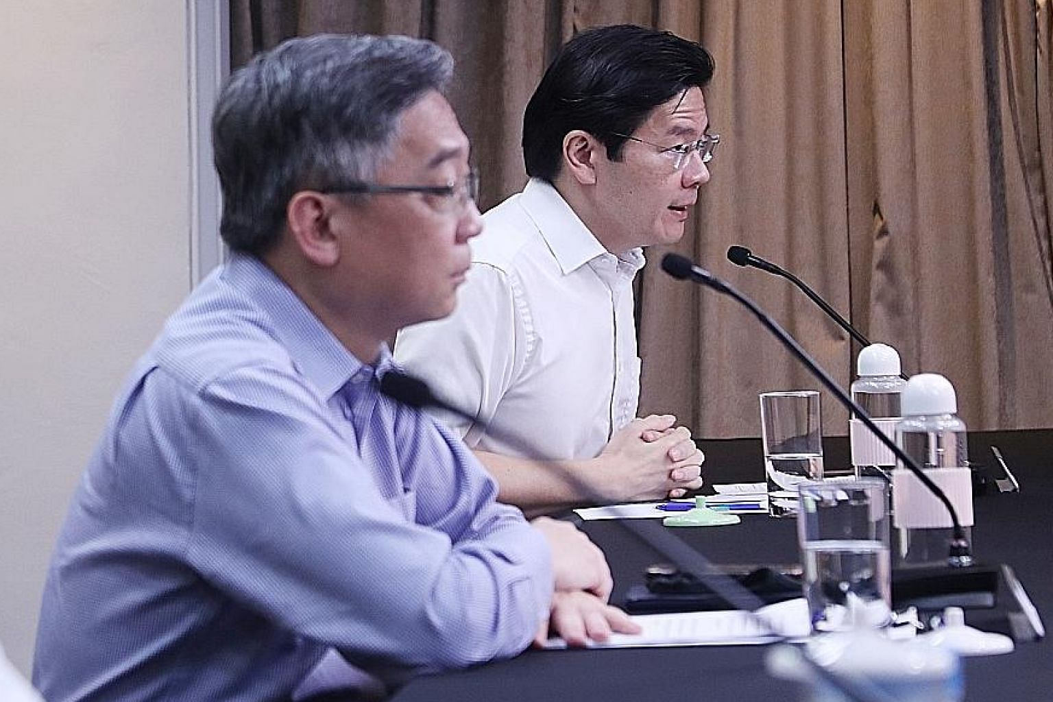 Health Minister Gan Kim Yong (left), who co-chairs the multi-ministry task force tackling Covid-19 with National Development Minister Lawrence Wong, said there would be continuity in the task force's leadership. PHOTO: MCI