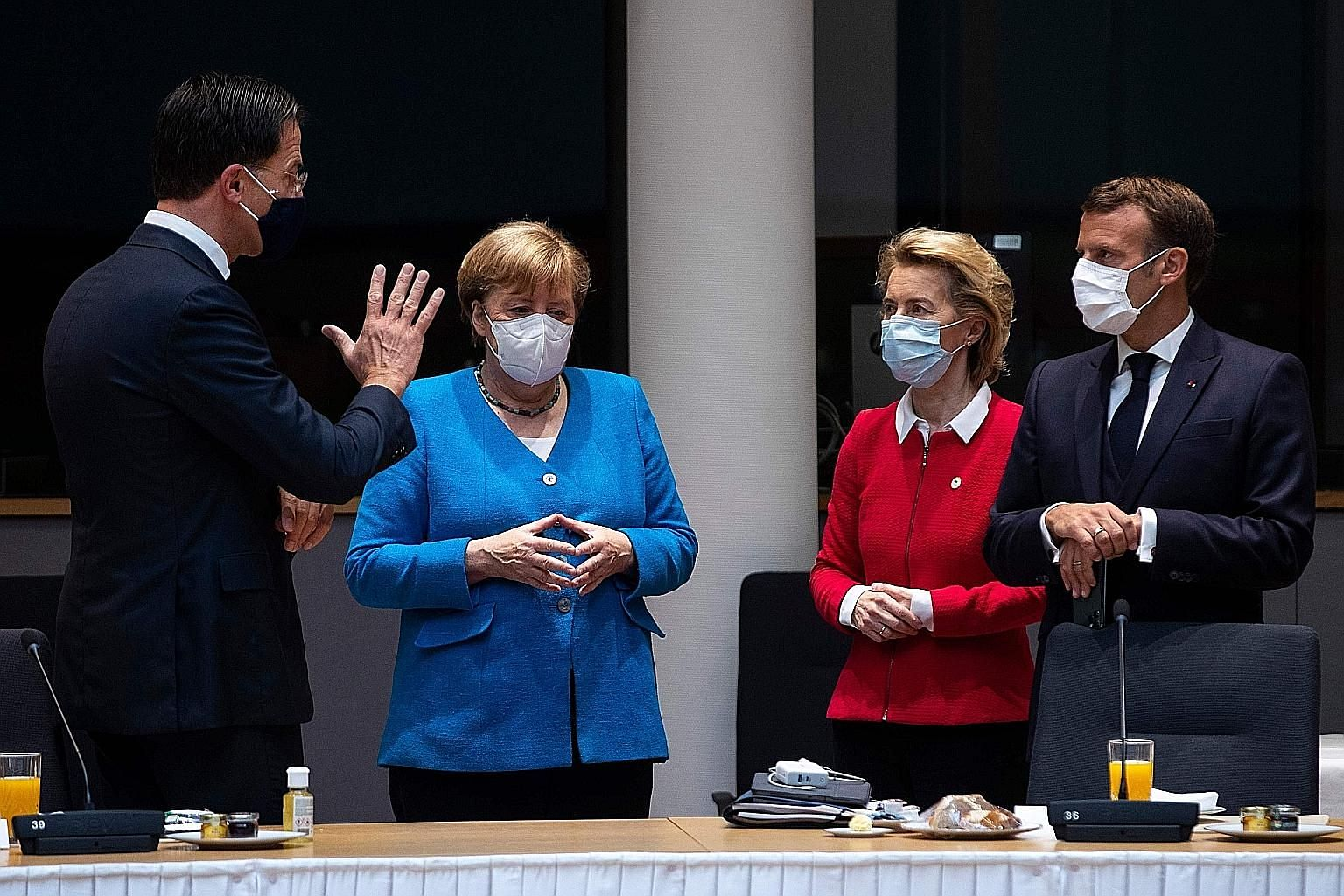 (From left) Dutch Prime Minister Mark Rutte, German Chancellor Angela Merkel, European Commission President Ursula von der Leyen and French President Emmanuel Macron meeting ahead of an EU summit at the European Council building in Brussels yesterday