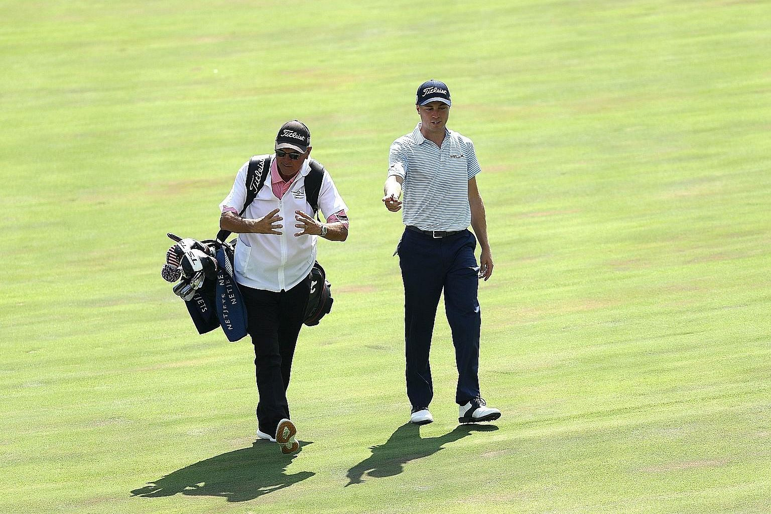 American Justin Thomas and his father Mike walking on the 17th hole during the third round of the Memorial. Mike, who is the world No. 3's swing coach, doubled up as caddie when usual bagman Jimmy Johnson fell ill. He also stepped in for Johnson in 2