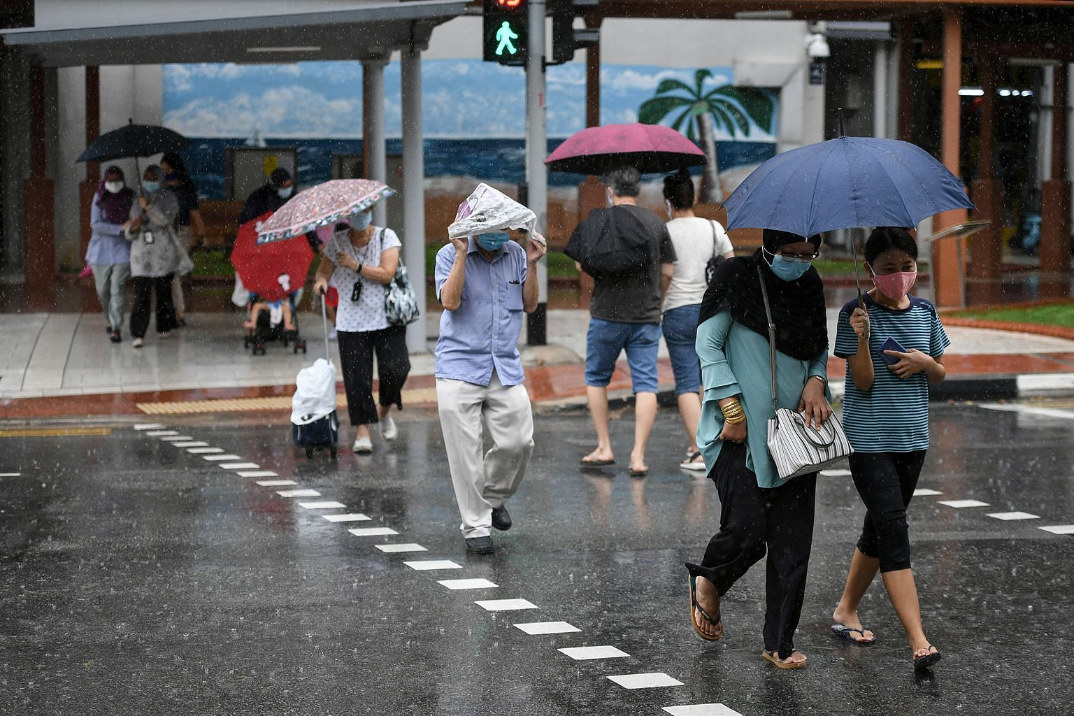 The wet weather in North Bridge Road last Monday. Looking at rainfall and mean temperature data for June and July over the past 20 years, there is a clear oscillating rhythm where temperature and rainfall peak in some years and fall in other years, s
