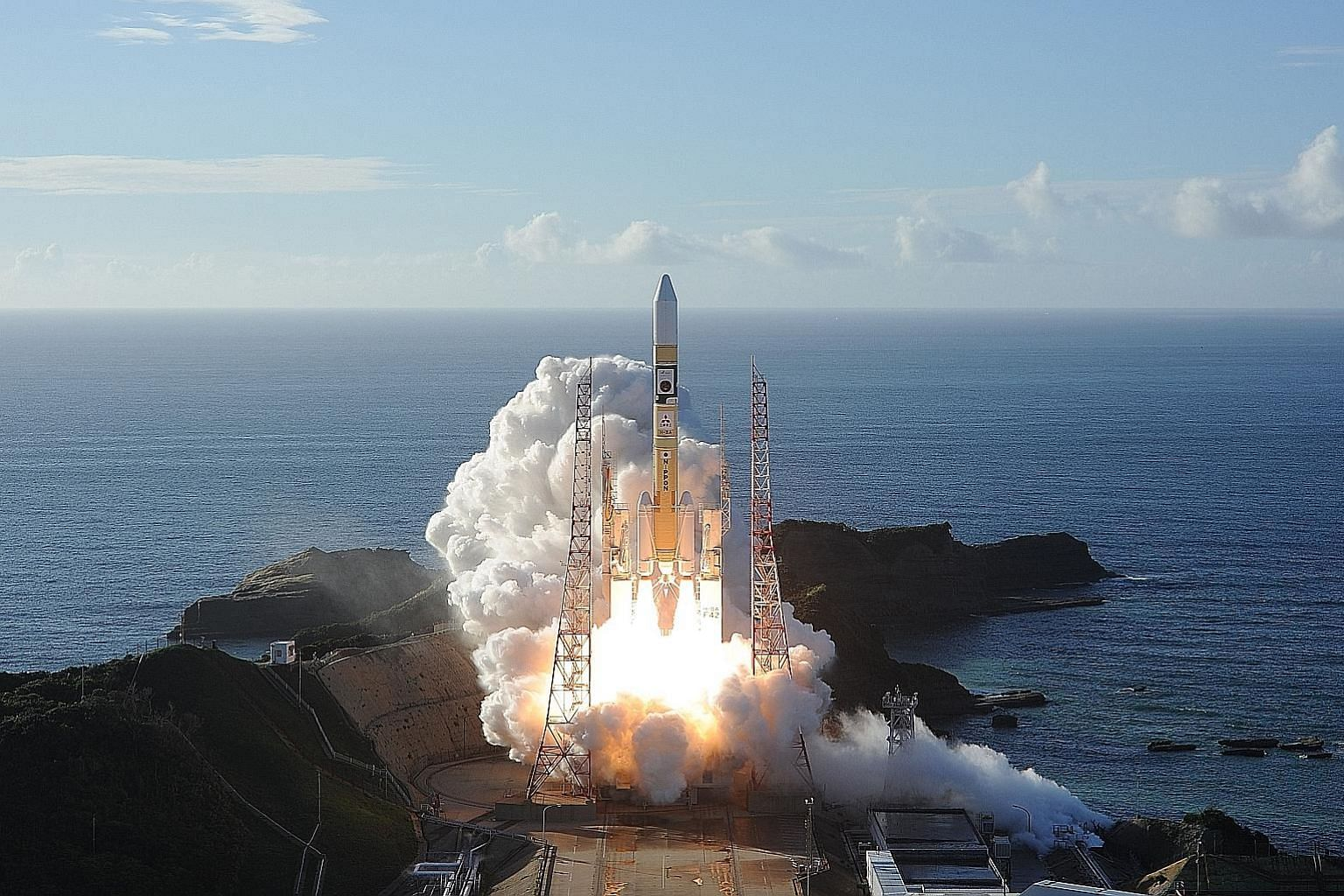 In this handout photo taken yesterday by Mitsubishi Heavy Industries, an H-2A rocket carrying the unmanned Al-Amal (or Hope) probe is seen blasting off from Tanegashima Space Centre in southern Japan.
