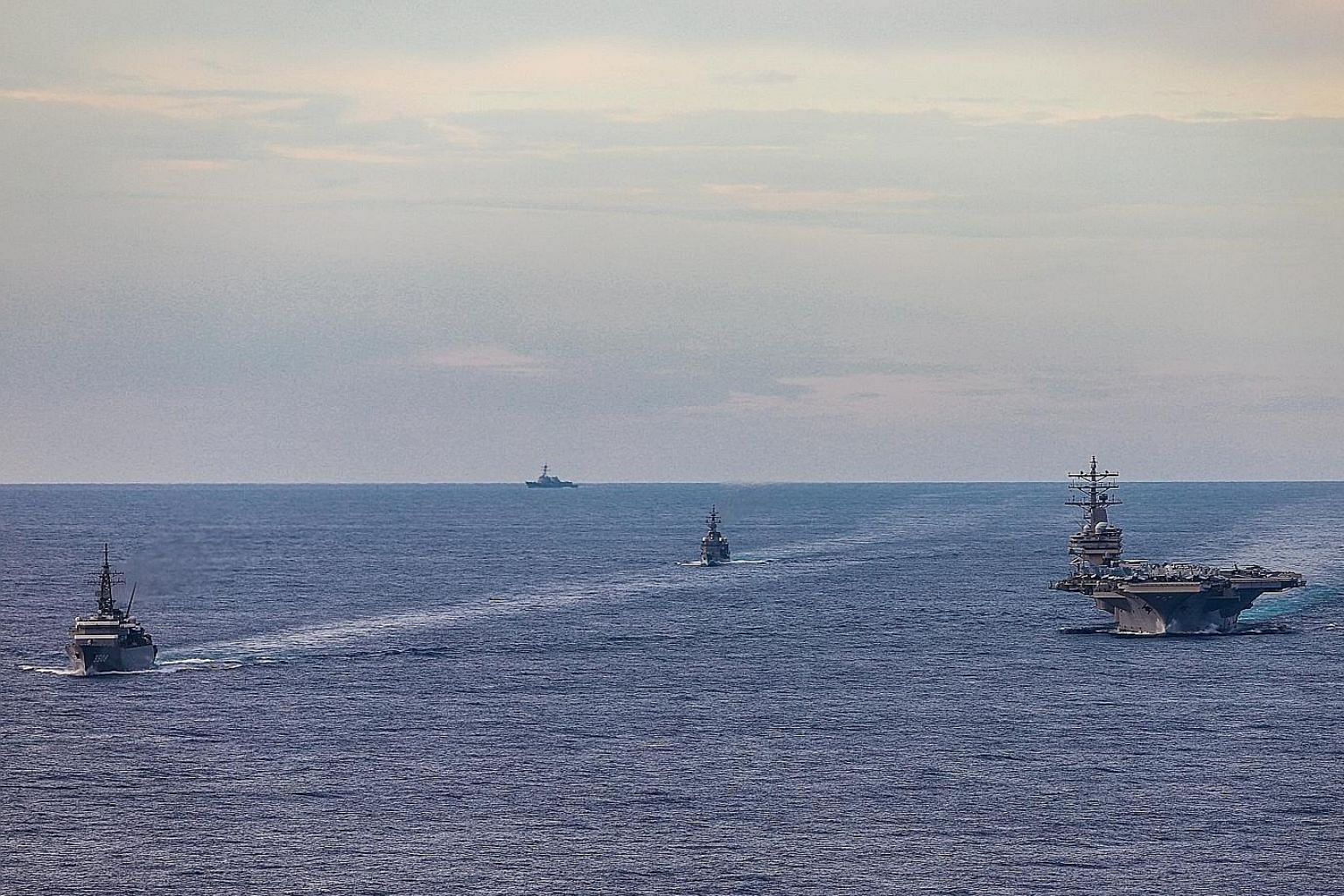 Japanese and American ships conducting a passing exercise during a drill in the South China Sea earlier this month. Under the Trump administration, the US has adopted a more hard-nosed policy towards China over a range of issues, including on the Sou