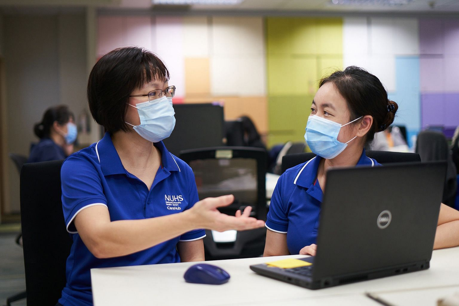 Ms Tay Yee Kian (left), assistant director of nursing at NUHS' Regional Health System Office, seen here with her colleague Yeo Ai Wah, led her team to supervise the set-up for Covid-19 swab testing at 15 nursing homes.