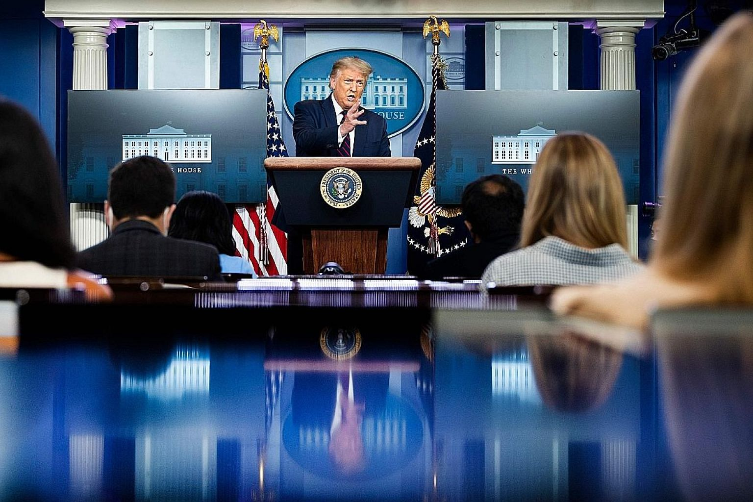 US President Donald Trump at the White House briefing on Tuesday. His reversal from his initial downplaying of the seriousness of the virus comes amid a spate of polls showing his Democratic rival Joe Biden expanding his lead into the double digits,