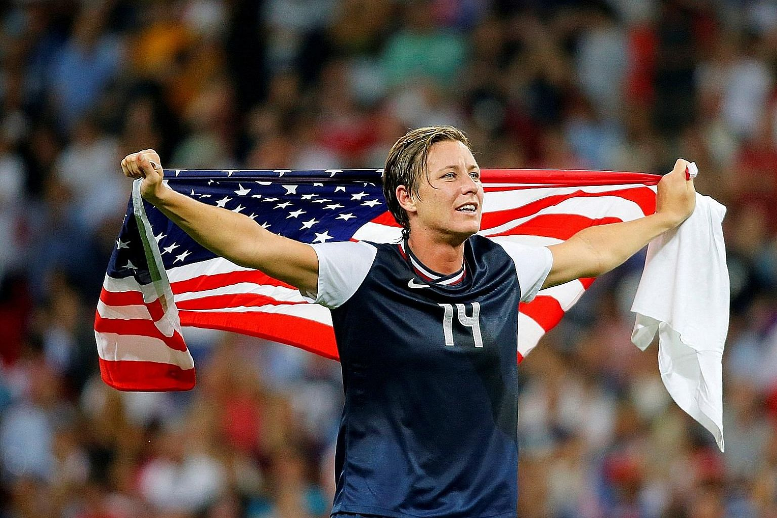 Abby Wambach (left) and actress Natalie Portman are among a group of investors to fund a new women's football team.