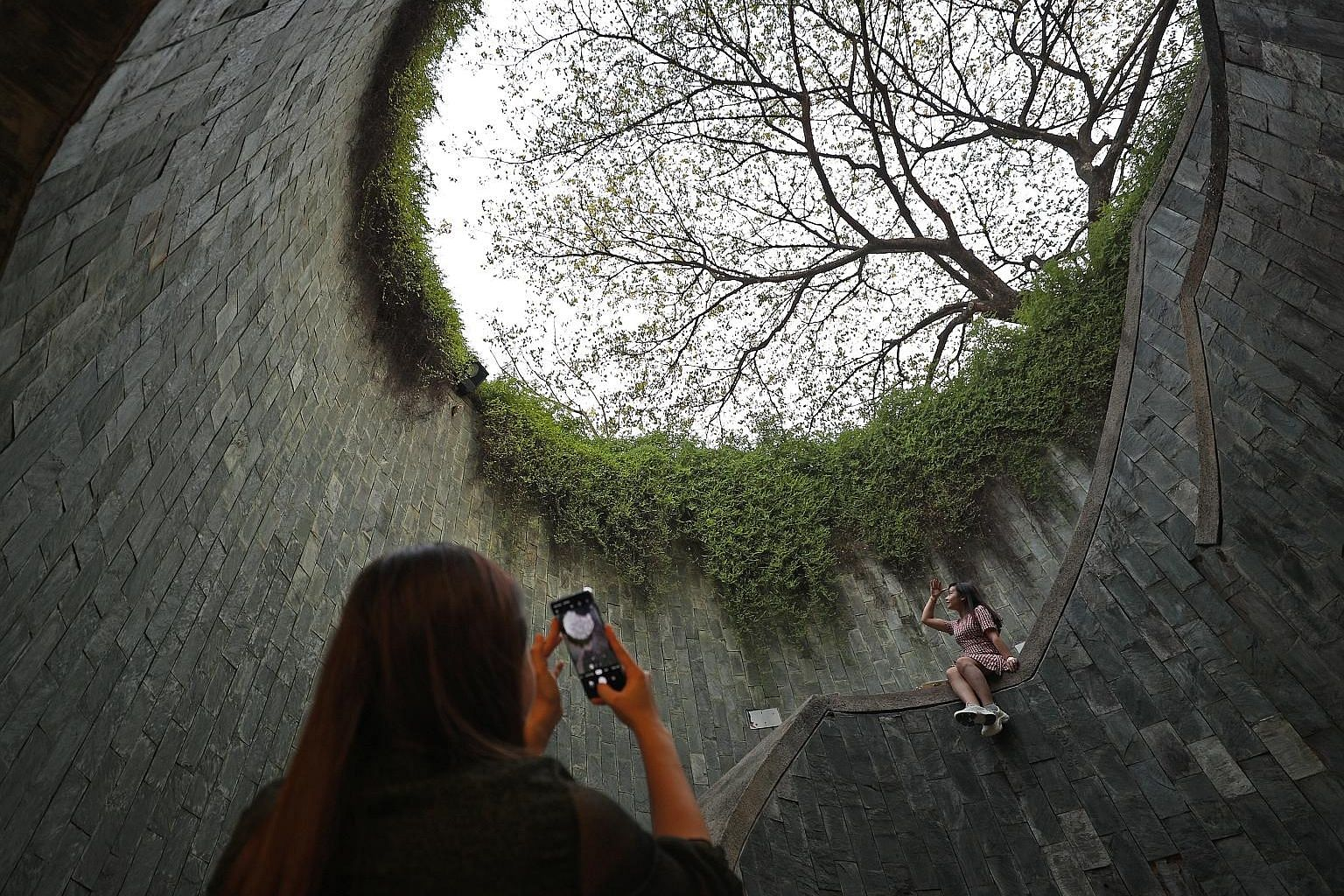 A staircase at Fort Canning that is a popular photography spot for tourists. The nine-month SingapoRediscovers campaign will have packages and deals for locals, heartland tours and the promotion of precincts as mini-holiday destinations. ST PHOTO: JA