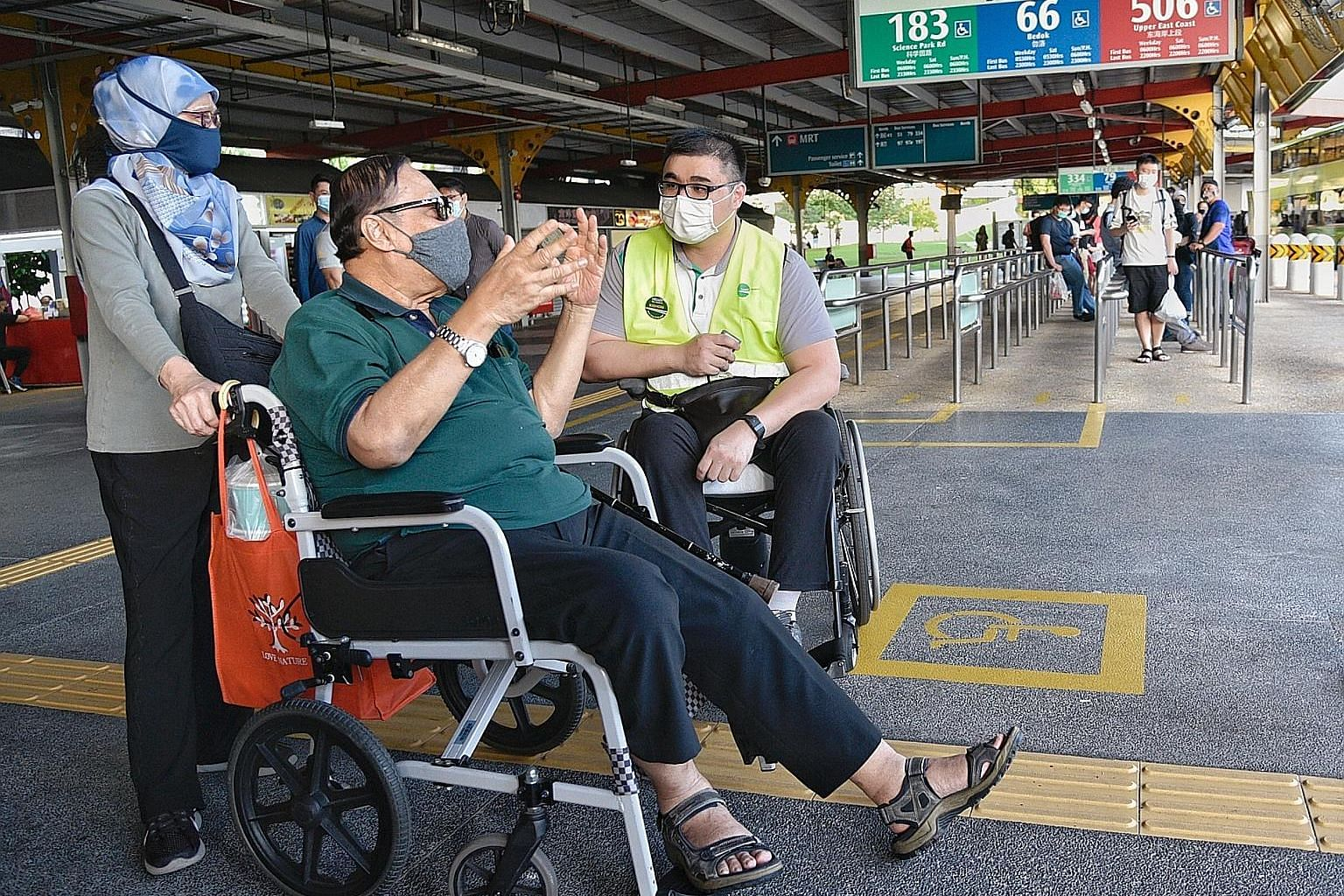 "Wheelchair user Kishon Chong (right) gathering feedback from two bus commuters last Friday at Jurong East bus interchange. ""This is a historic change,"" says the Public Transport Council chairman of Mr Chong's role as a customer experience and inclusi"