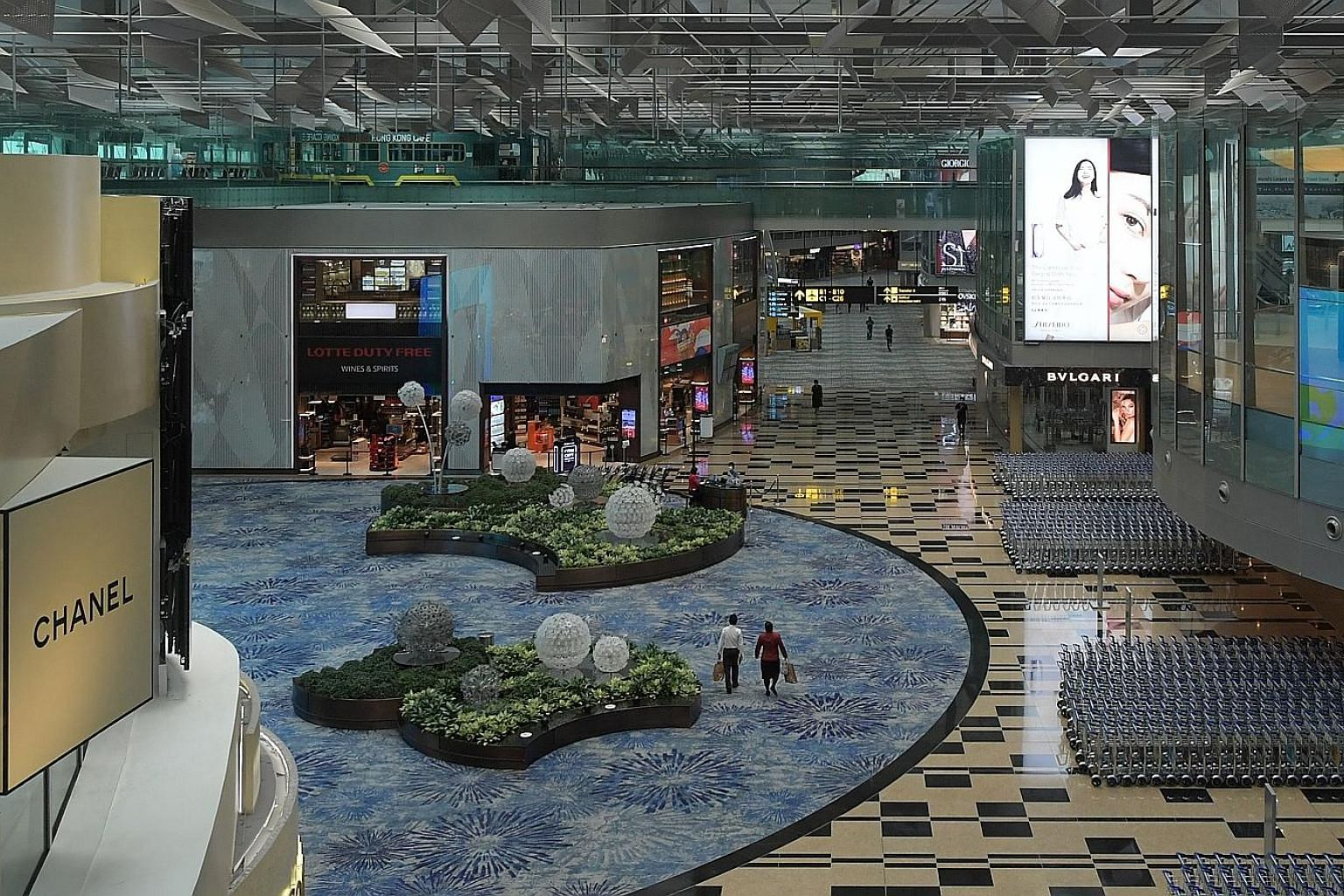 A near-empty transit area in Changi Airport Terminal 3 in June. Professor Teo Yik Ying of the Saw Swee Hock School of Public Health said at the ST webinar that people are exposed to various factors beyond their control when they travel.