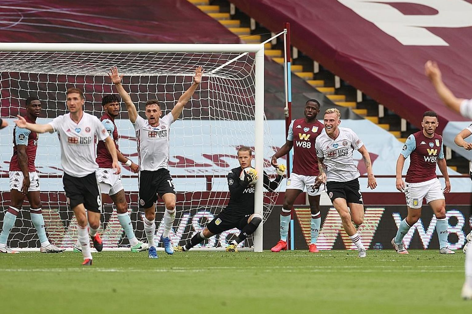 Sheffield United celebrating a goal against Villa prematurely on June 17. Goal-line technology failed to work and VAR could not intervene.