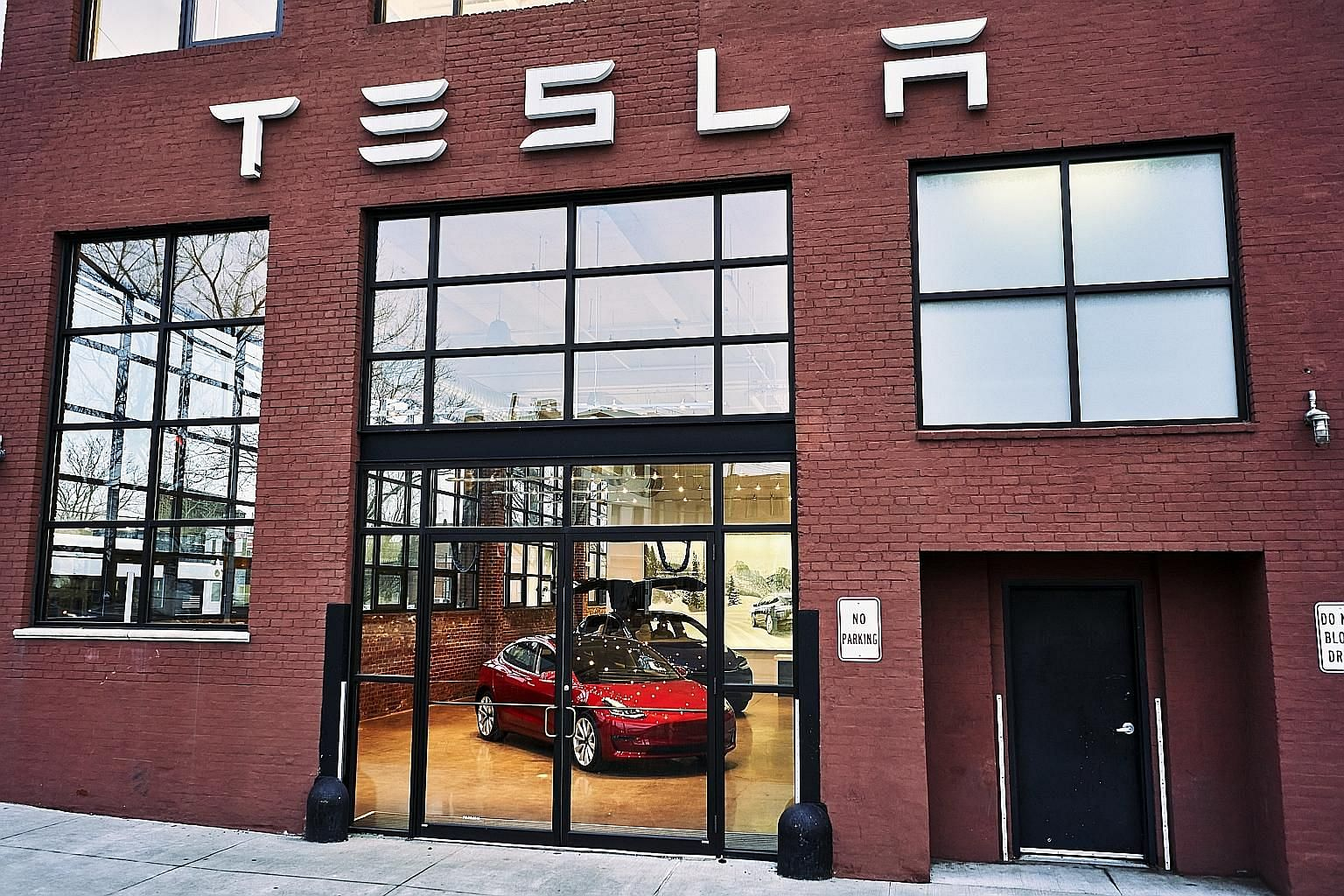 A Tesla showroom in the Red Hook section of Brooklyn in February. While several carmakers have added new models intended to cut into Tesla's electric dominance, they have barely made a dent, at least in the United States.