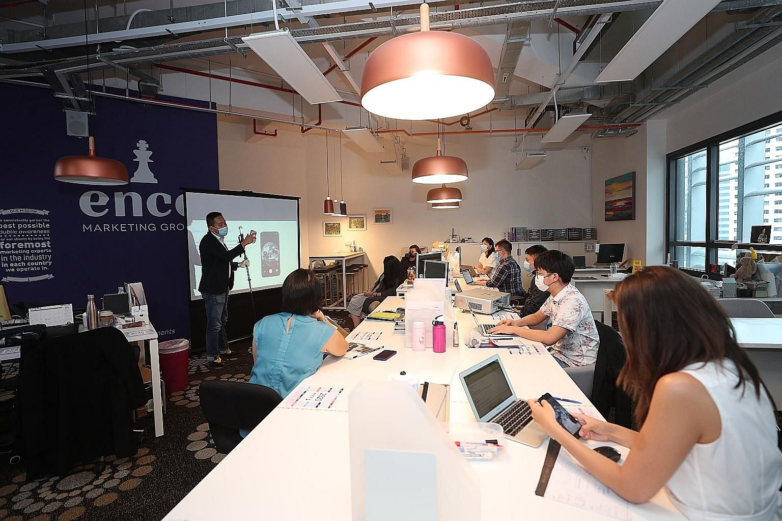 (Above) At the 12 co-working spaces operated by WeWork in Singapore, vinyl floor decals and wall signs displaying the expected 1m safe distancing can be found in the hallways and community areas. Ms Sheila Cheng, a family and divorce lawyer at law fi