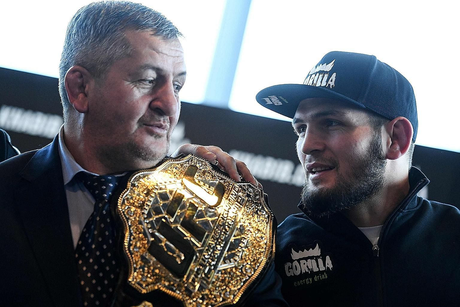 """Khabib Nurmagomedov with his father in 2018. UFC chief Dana White says Abdulmanap's death this month from Covid-19 effects has """"been very rough"""" on the Russian MMA fighter. PHOTO: AGENCE FRANCE-PRESSE"""